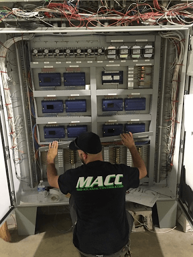 MACC technician repairing a building automation system