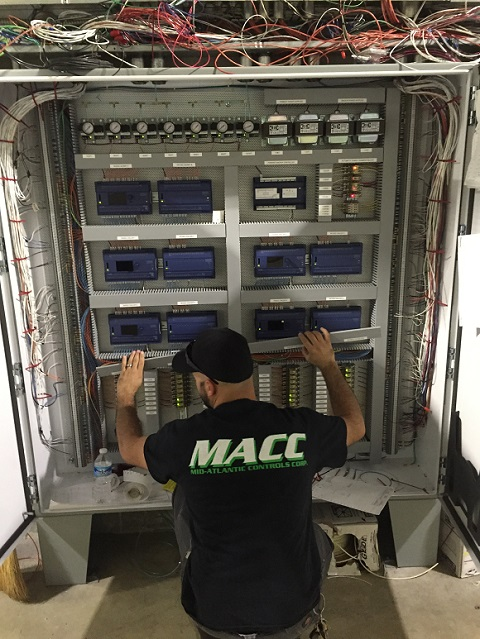 BAS-Tech-Installing-Equipment-Copy.jpg