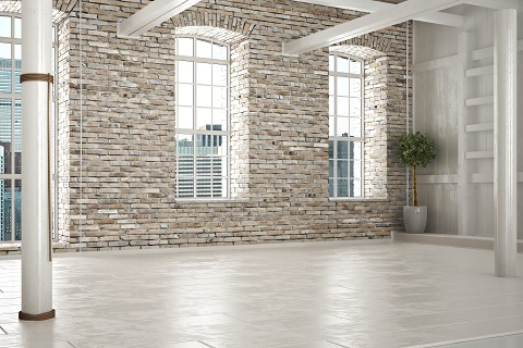 Empty room of business,or residence with brick interior and a ci