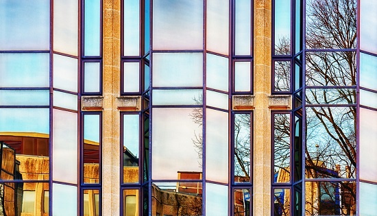 Reflections in a glass fronted building