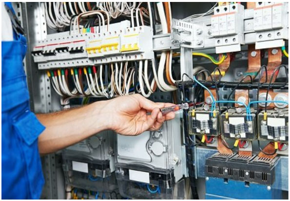 a technician performing building automation system maintenance